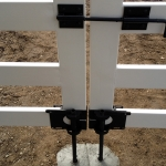 white-double-gate-black-ground-anchor