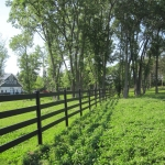 pasture-fence-line-with-barn-compressed