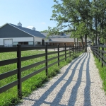 fence-lining-walkway-to-barn
